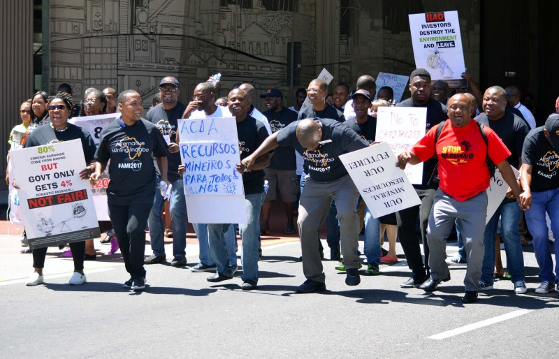 Delegates from the Alternative Mining Indaba protest outside the industry's Mining Indaba in Cape Town. Photo: Mark Olalde